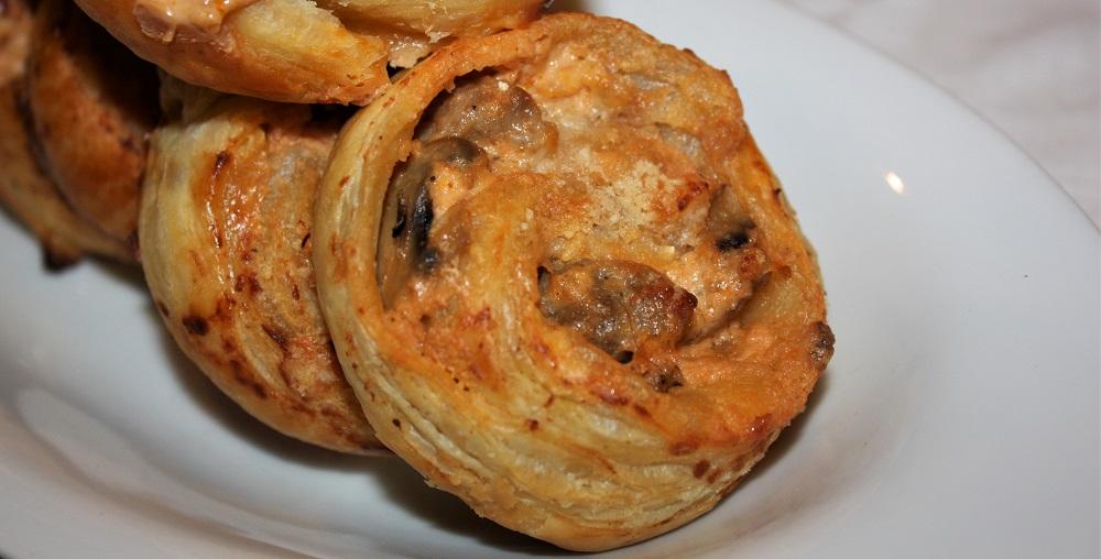 Girelle con salsiccia funghi e parmigiano